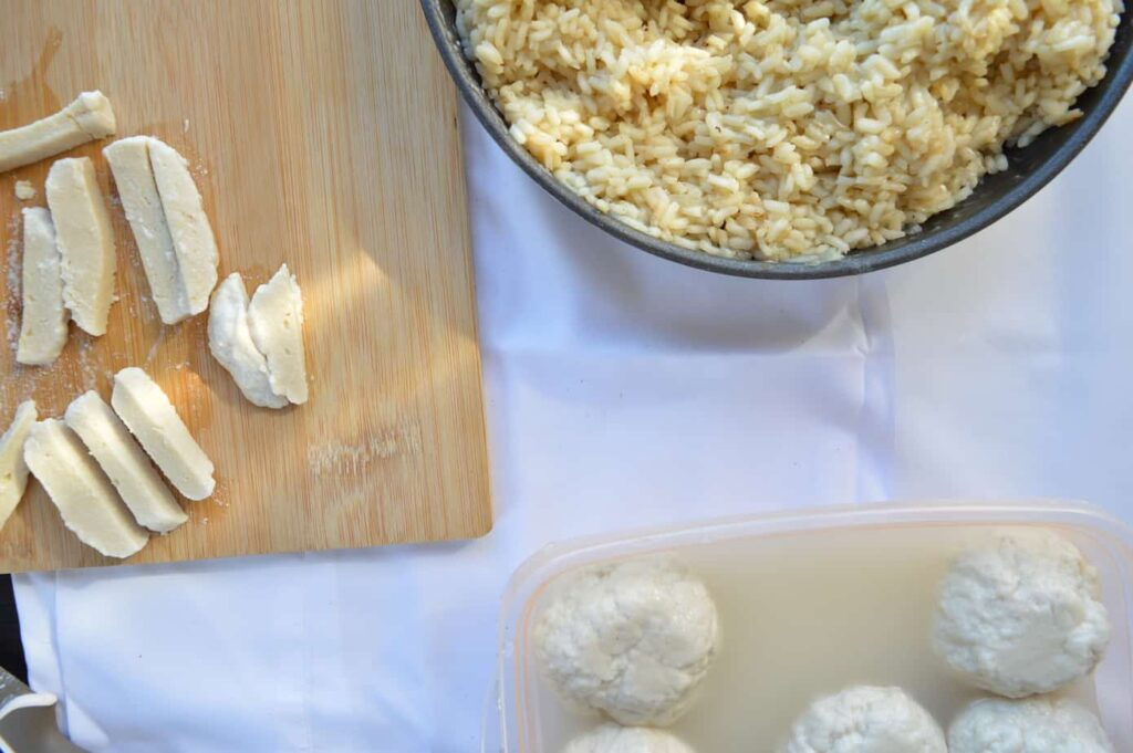 vegan Mozzarella on wooden chopping boards and a bowl of risotto c
