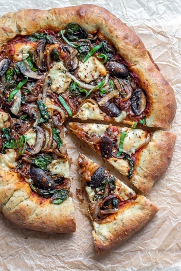 A sliced mushroom pizza