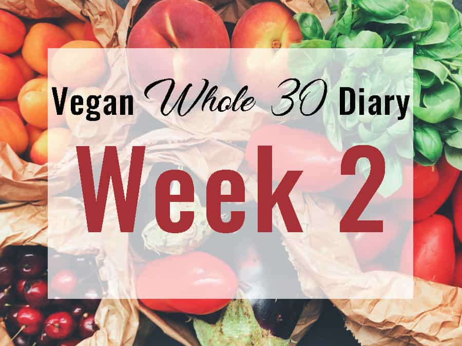 A picture of fruit and vegetable in sacks with Vegan Whole 30 Diary Week 2 superimposed