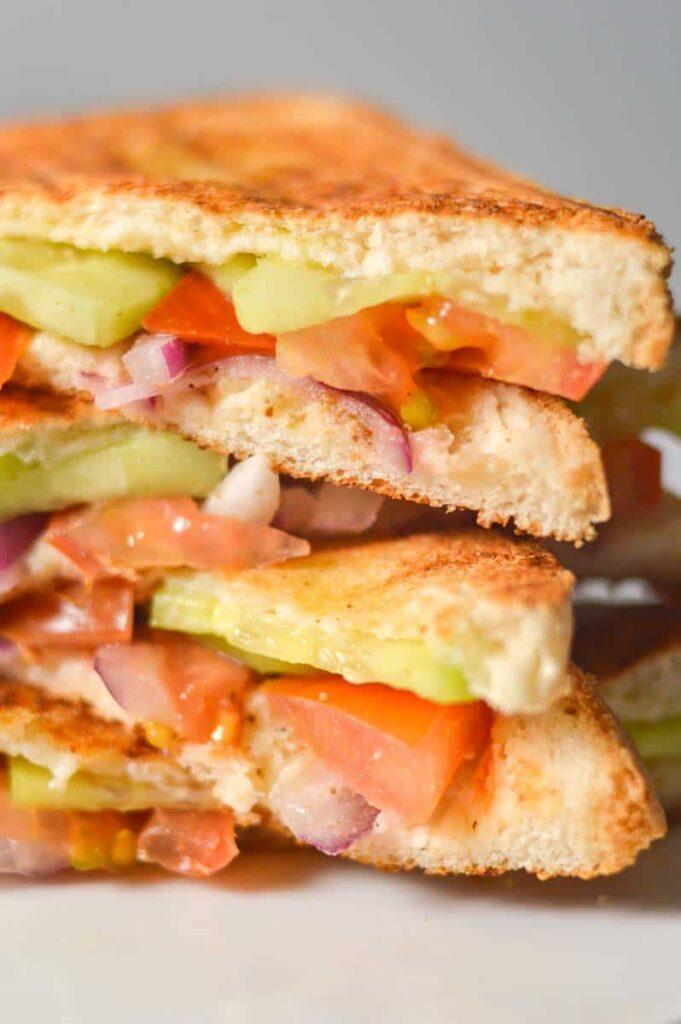 A close up of a vegetable sandwich pile