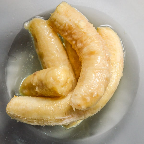 2 bananas and oil in a glass bowl