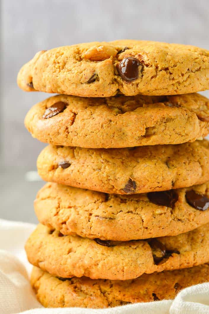 stack of six chocolate chip cookies with grey background