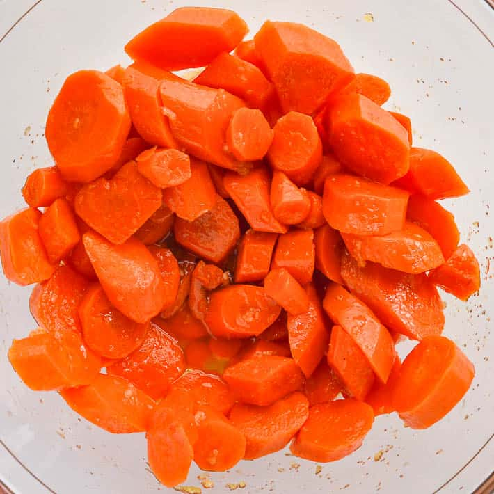 A bowl of glazed carrots with sauce